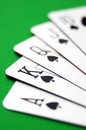 Royal flush of spades poker cards closeup on green table Stock Photography