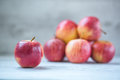 Royal gala apples bunch of red focus on front apple Stock Photos