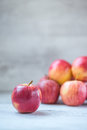 Royal gala apples bunch of red on table focus on front apple Royalty Free Stock Image