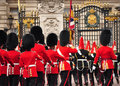 Royal guards march toward buckingham palace Royalty Free Stock Photography