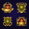 Royal heraldic vector emblems in victorian style with golden crown, shield and laurel wreath