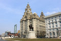 Royal liver building and king edward vii statue by sir william goscombe john on the waterfront near the pier head in liverpool Royalty Free Stock Photography