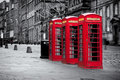 Royal mile red telephone booths along the famous in black and white in edinburgh capital of scotland united kingdom Royalty Free Stock Images