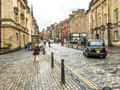 The royal mile street in edinburgh old town uk united kingdom april tourists walk at s and new Royalty Free Stock Photography