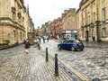 The royal mile street in edinburgh old town uk united kingdom april tourists walk at s and new Stock Photo