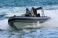 Royal new zealand navy sailors ride a zodiak rigid hulled inflat auckland nzl jan inflatable boat in ports of auckland the rnzn Royalty Free Stock Photography