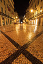 Rua augusta cross night scene of the and its cobblestones in lisbon portugal Royalty Free Stock Photography