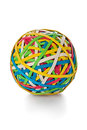 Rubber band ball made from colored bands against a white background Stock Images