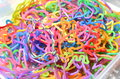 Rubber band bracelets a pile of brightly colored children s Stock Images