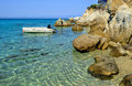 Rubber boat dinghy anchored nearby small lagoon hidden among rocks sithonia greece Stock Image