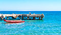 rubber boat near the pier in the sea Royalty Free Stock Photo