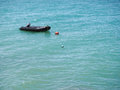 Rubber boat in the sea Royalty Free Stock Photo