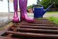 Rubber boots on rainy days Royalty Free Stock Photo