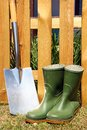 Rubber boots and spade Royalty Free Stock Images