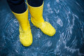 Rubber boots in the water Royalty Free Stock Photo