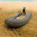 A rubber dinghy on a beach Royalty Free Stock Photo
