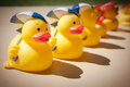 Rubber ducks holding umbrellas in a row Stock Photography