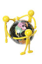 Rubber Figures and World Globe Royalty Free Stock Image