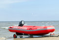 Rubber lifeguard boat trailer on sea shore Royalty Free Stock Photo