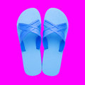 Rubber slippers isolated on pink backgroundn Stock Photos