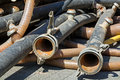 Rubber tubes with couplings on a construction site used tubings Royalty Free Stock Photography