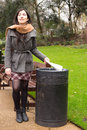 Rubbish bin young woman throwing in the Royalty Free Stock Image