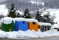 Rubbish bins and bins for separate waste collection in a mountain town with snow Royalty Free Stock Photography