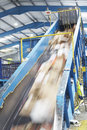 Rubbish on conveyor belt in recycling factory motion of Royalty Free Stock Photography