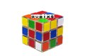 Rubiks text message on cube and white surface background Stock Photography