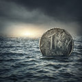 Ruble coin sinking in water russian economic crisis concept Stock Photography