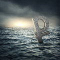 Ruble sign sinking in water russian economic crisis concept Royalty Free Stock Photo
