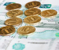 Rubles coins and rubles banknotes against background of Royalty Free Stock Photo