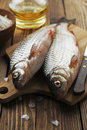 Rudd ide fresh fish on a wooden table Stock Photos