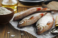 Rudd ide fresh fish on a wooden table Royalty Free Stock Images