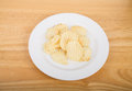Ruffled potato chips on white plate and wood table a Royalty Free Stock Photos