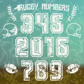 Rugby numbers for t shirt with contour white print on blurred background Royalty Free Stock Photo