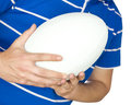 Rugby player holding ball on white Stock Image