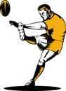 Rugby player kicking ball Royalty Free Stock Photos