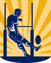 Rugby player kicking at goal post Royalty Free Stock Photo