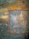 Rugged aged steel a rich textured surface of a piece of industrial patched metal Royalty Free Stock Image