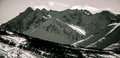 Rugged alaska mountain peaks black and white perfection a perfect slight slope on the bottom in the foreground has brush Stock Photography