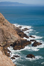 Rugged cliffs along marin headlands rocky coastline california usa view of across san francisco bay to mountains in Royalty Free Stock Photography
