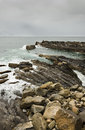 Rugged coastline cantabrian sea the atlantic ocean meets spanish far away a fisherman and some cormorants Stock Photos