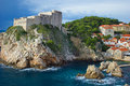 Rugged coastline of the city of Dubrovnik, Croatia overlooking blue swells on the Adriatic Sea. Royalty Free Stock Photo