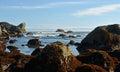 Rugged oregon shore line view of rocks along Stock Photos