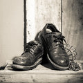 Rugged shoes in wooden box still light Stock Photography