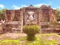 ruin of buddha statue behind the ruin