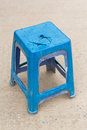 Ruin chair close up blue color plastic on concrete floor time to change new one concept Royalty Free Stock Photo