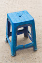 Ruin chair close up blue color plastic on concrete floor time to change new one concept Stock Image