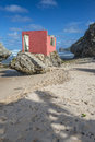Ruined beach house bathsheba barbados deserted and on a at washed away from mainland still attached to rock Royalty Free Stock Photos